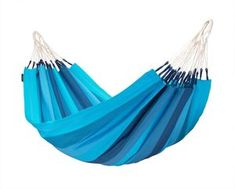 Comfortable single hammock ORQUIDEA lagoon – as fresh and blue as the ocean. Produced in Colombia from pure, high-quality cotton. Hanging Hammock Chair, Outdoor Hammock, Swinging Chair, Hammock Accessories, Adirondack Chairs For Sale, Dining Room Chairs, Simple, Flora, Aqua