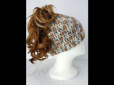 "Here is an easy to crochet ""Messy Bun"" hat. They make great gifts and can be made in your favorite colors or maybe your ""team colors"" I had so many requests ..."