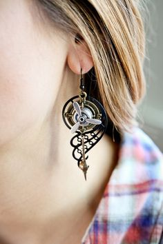 "These amazing Steampunk ""flight"" Earrings are truly wearable art combining propellers, compass dials, clock pendulums and vintage filigree into superb Steampunkery. These highly intricate designs are"
