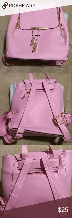 Small Pink Backpack Gently used (only used for a 4 day road trip,) a few very light & small scratches that are not noticeable. Plastic still on some gold hardware pieces. Top handle Cellphone pocket Interior zipper pocket Front clasp 11in x 10in x 6.5in Polyurethane leather & polyester for lining Bags Backpacks