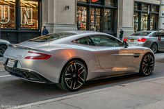 The rear end of the Aston features a sleek fastback design and a partially integrated spoiler.