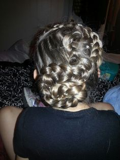 Two French braids rolled into buns