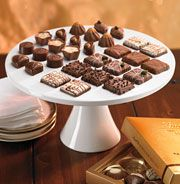 """Another pinner said: """"Display your LINDT pralines on a white tray to contrast the rich, chocolate color. Lindt Truffles, Lindt Lindor, Lindt Chocolate, Chocolate Color, Tea Party Desserts, White Tray, Easter Traditions, Sponge Cake, Its A Wonderful Life"""