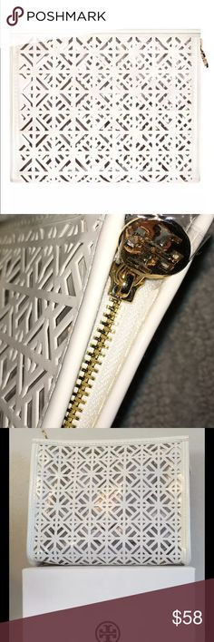 Tory Burch White Snowflake makeup bag Brand-new in box beautiful Tory Burch White Snowflake makeup bag must see to appreciate my price is firm offers not accepted. Tory Burch Bags Cosmetic Bags & Cases