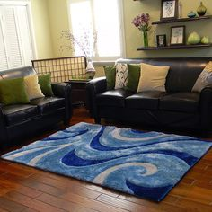 Enhance your home decor with this stunning area rug. With its abstract pattern, this area rug features rich shades of blue to complete the look.