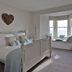 New England-style bedroom with heart wall art | Cornwall modern country house | House tour | PHOTO GALLERY | Country Homes and Interiors | Housetohome.co.uk