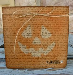 By Kelley Eubanks. Halloween Card. Text background. Eyes, nose, mouth masked; then the rest of the card sponged. Add twine, sentiment, gem.