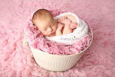 Palm Springs, CA newborn photographer www.capturedbyerin.com  newborn in prop, pink flokati, newborn in wrap, newborn girl