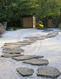 A japanese rock garden with a path