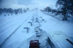 """Cars are abandoned on Chicago's Lake Shore Drive during the """"Snowpocalypse"""" in February."""