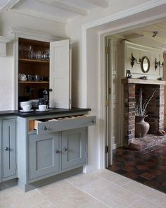 Farrow & Ball Pigeon no. 25 base cupboard. It is an interesting hue that can look blue, green or grey depending on the light. It works well with cool Off- White No 3, Lime White No 1 or Shaded White No 201 and also the slightly darker Old White No 4.