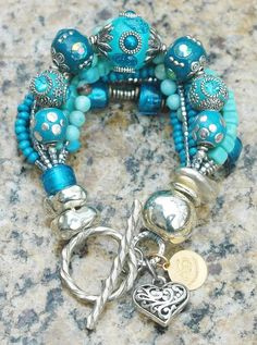 Glitz and Glam Blue and Silver Heart Charm Statement Bracelet