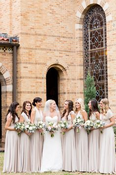 Beautiful bridal party in oyster ballgowns! 7 bridesmids