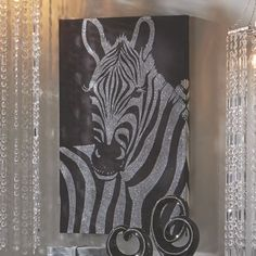 Silver Glitter Zebra Canvas from Midnight Velvet.  It's hard to beat the zebra's natural graphic impact, but this art canvas may have crossed the line into genius.