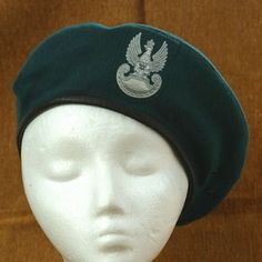 When not in combat wearing a helmet, infantry units wore this cap for sleek camouflage. These hats also kept the infantry units warm with it's double thickness layers. The front of the hat have a Polish army eagle insignia. Inner layer is equipped with a leather strap.