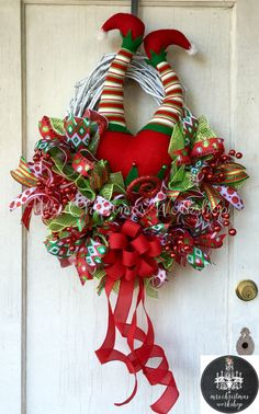 Christmas grapevine wreath elf wreath with legs deco mesh wreath elf butt booty wreath by MrsChristmasWorkshop on Etsy https://www.etsy.com/listing/252692364/christmas-grapevine-wreath-elf-wreath