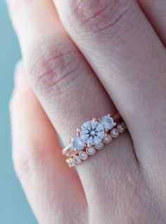 Gorgeous rose gold, three stone engagement ring. Loving the mismatched wedding band too!