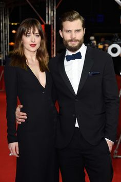 Dakota Johnson and Jamie Dornan Photos - Actress Dakota Johnson and actor Jamie Dornan attend the 'Fifty Shades of Grey' premiere…