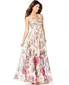 """This Adrianna Papell halter dress is listed in Macy's as an """"evening gown"""".  Perhaps, but I think it works nicely as a more formal sundress.      What's really clever, though is the pattern.  Too often a dress's pattern can overwhelm, especially a floral print on a maxi length.   This instead transitions nicely."""