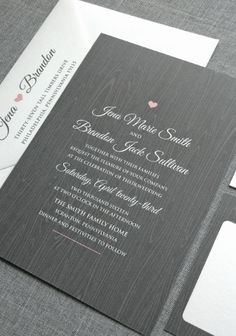 Pink & gray wedding invitation with wood grain background