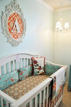 Vintage Baby Room… definitely leaning toward the orange, white, and a soft blue/aqua combo. particularly for a girl.