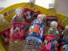 Water bottles using Mickey Mouse wrapping paper and packing tape.