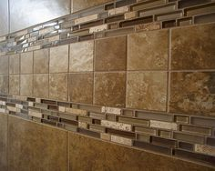 "I like the glass tile accents to ""lighten"" the dark tile I would like to do.  I also like the tumbled stone worked in.  Just not the square tiles, probably. 4 Ceramic Tile Shower by Wayne Homes, via Flickr"