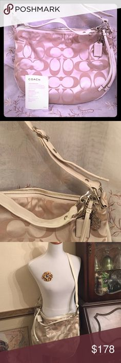 Beautiful Authentic Coach Signature Bag Coach Signature Collection Bag, beautiful design, like new condition, carried one occasion . Authentic . Lovely Crossbody style Coach, can also carry as a handbag, has a adjustable strap. Has a long zipper pull and two coach hangtags. Coach Bags Crossbody Bags
