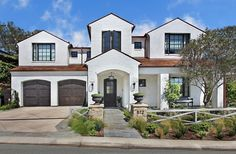 White Home Exterior Color Ideas- with black windows, landscaping...