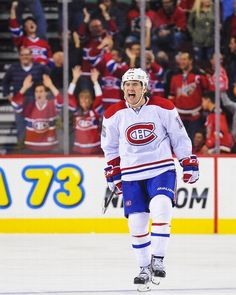 Parenteau of the Montreal Canadiens reacts after scoring the game-winning goal against the Calgary Flames during an NHL game at Scotiabank Saddledome on October 2014 in Calgary, Alberta,. Hockey Goal, Ice Hockey Teams, Hockey Players, Montreal Canadiens, Nhl Games, Club, Best Player, Espn, Team Logo