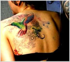 Unique Hummingbird Tattoo For Girls On Upper Back - http://tattoosaddict.com/unique-hummingbird-tattoo-for-girls-on-upper-back.html #back, for, girls, hummingbird, hummingbird tattoo, on, tattoo, unique, upper