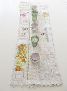 Table runner from vintage linens and doilies. I could do this with my Abuelita's doilies as a rememberence to her.