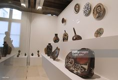 A visitor looks at ceramics by Catalan artist Joan Miro, displayed as part of the exhibition ' Miro Sculptor ' at the Maillol museum in Paris on March 16, 2011. The exhibition runs from March 16, to July 31, 2011.
