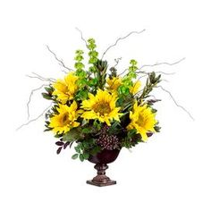 Faux sunflower, protea, and bells of Ireland arrangement in a classic urn.   Product: Faux floral arrangementConstruction Materials: Faux florals Color: Yellow, green and brown  Features: Included sunflower, protea and bells of Ireland  Comes with urn    Dimensions: 24 H