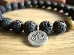 Mens Om Bracelet with Matte Black Lava Stone and Tiger's Eye by MerkabaWarrior