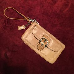 Coach Wristlet Authentic Coach Wristlet. Gently used. Great to throw in your purse or just carry by itself. Coach Bags Mini Bags
