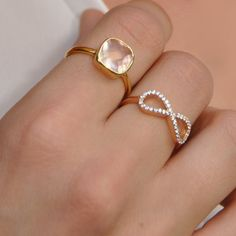 Rose quartz gemstone ring set in 18k gold vermeil over sterling silver. The perfect accessory or gift for a loved one.  Gemstone: Rose Quartz Stone Cut: Cushion Cut Stone Size (mm): 9mm Metal: 18K Gold Vermeil over sterling silver Your ring will come gift wrapped in a box