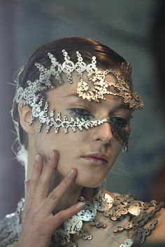 Headpiece style - metal, intertwining designs, mask-that-isn't - modified for war or wedding.