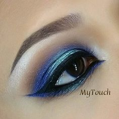This look by mytouch has us feeling anything but blue! Here she uses Makeup Geek Signature Eyeshadows in Cocoa Bear and Shimma Shimma with Makeup Geek Foiled Eyeshadows in Center Stage and Pegasus.
