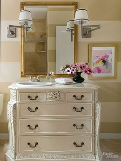 Rather than using standard cabinetry, consider creating a sink vanity out of an old dresser. A cabinetmaker can cut a hole in the top of the dresser to fit a drop-in sink. Cover the top of the dresser with a slab of countertop in the material of your choice. Paint the dresser a punchy color to update it even further.