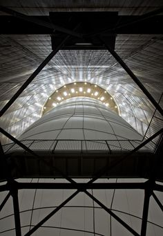 """The artist duo Christo and Jeanne-Claude have created a beautiful indoor installation for the Gasometer Oberhausen. Presented until the end of 2013, this ball """"Big Air Package"""" 90 meters high and 50 meters in diameter inflated – Fubiz™"""