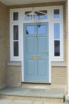 Stunning Chalfont style timber entrance door with a diamond patterned toplight. Finished in a colour complementary to Farrow & Ball's 'Dix Blue'. Polished Brass ironmongery from Samuel Heath. Manufactured in Engineered European Redwood. Timber Front Door, Double Front Doors, Timber Windows, Front Door Entrance, House Front Door, Front Door Colors, House With Porch, Windows And Doors, House Doors