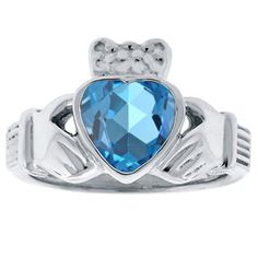 Blue Topaz Birthstone Heart Irish Claddagh Symbol Wedding Ring In White Gold Available Exclusively at Gemologica.com silver claddagh ring birthstone diamond claddagh ring claddagh wedding ring claddagh ring with birthstone FINE JEWELRY AT GEMOLOGICA.COM