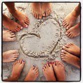 heart with feet on the beach
