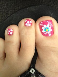 Cute! I prob wouldn't do them together. I would probably paint them all pink and do the big toes in either design (polka dots or the flower)