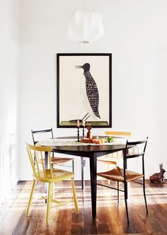 Mixed media dining space with modern pendant light