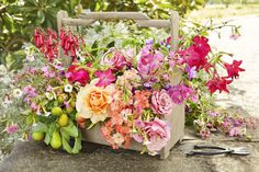 """Wooden Toolbox:  Give a crusty old toolbox a pretty purpose. The low height makes this ideal for an outdoor centerpiece. """"I rounded up everything from my garden - there's a lot of movement that gives a sense of the wild,"""" Kiana says."""