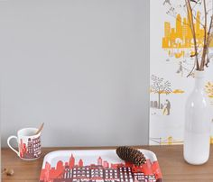 Launching this week, Famille Summerbelle's new wallpaper and accessory collection: Manhattan. Never to disappoint, we love the new detailed illustrations of people and the skyline of a 'Morning in Manhattan'. If you look closely you can even spot a pretzel...