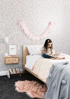 Same wallpaper but in a girls space. Again softened by the soft colours and natural timber.