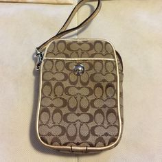 Coach Wristlet Coach Wristlet, new, tag is in the pocket, I took it off, but I have not used this. Had it safe in a fabric covered bin. See photos. Coach Bags Clutches & Wristlets